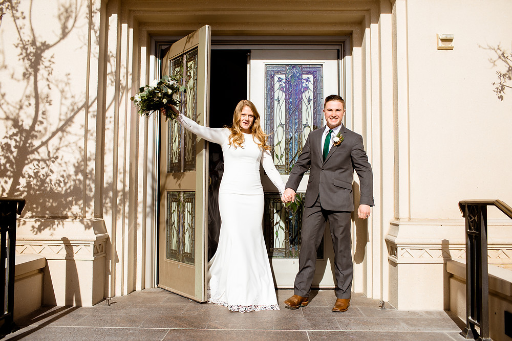 bride and groom exiting the payson, utah lds temple after their wedding ceremony