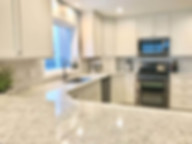 Updated Modern White Kitchen and Stainless-Steel Appliances