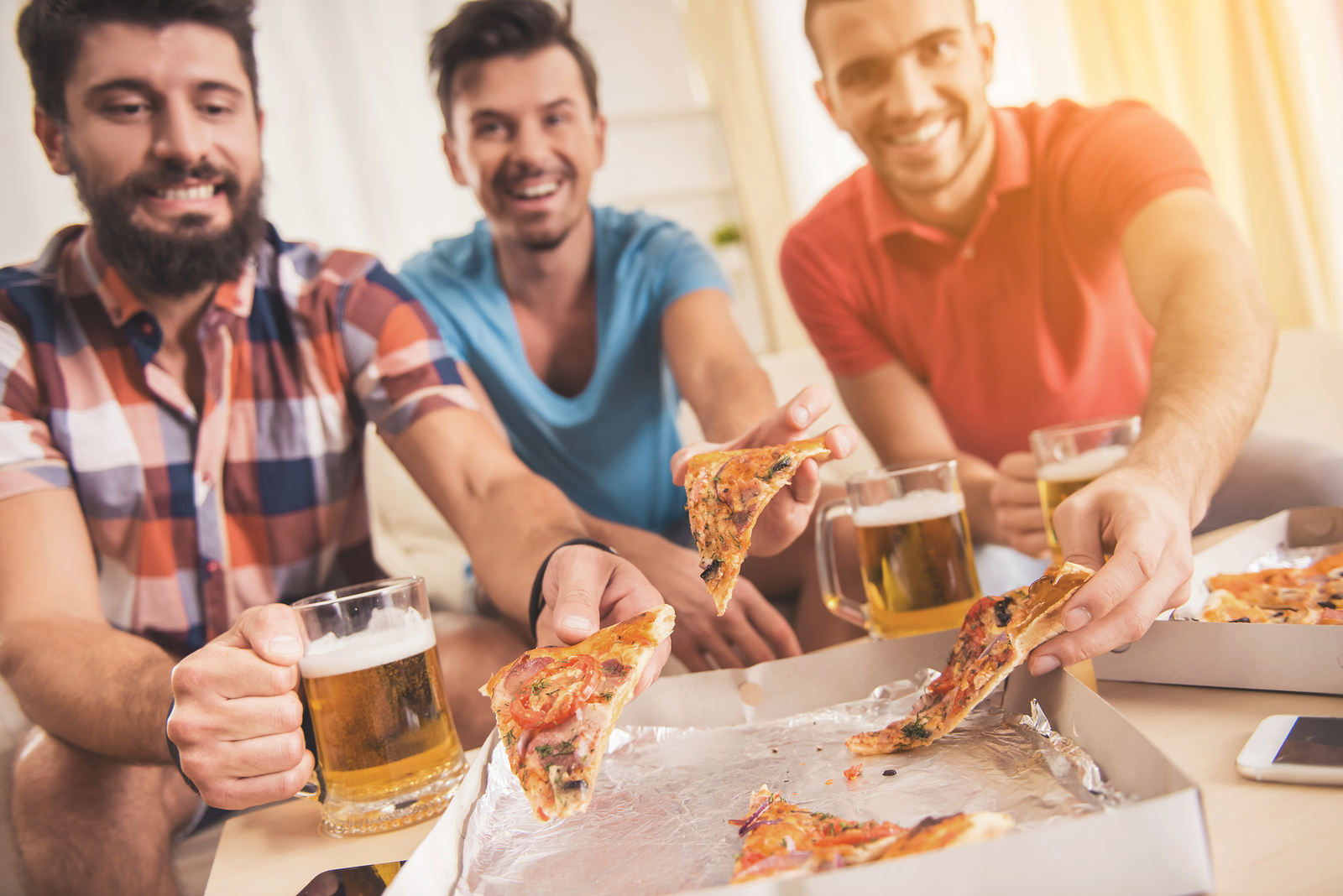 bigstock-Young-Smiling-Men-Drink-Beer-A-