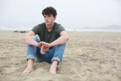 merman, teen boy on beach