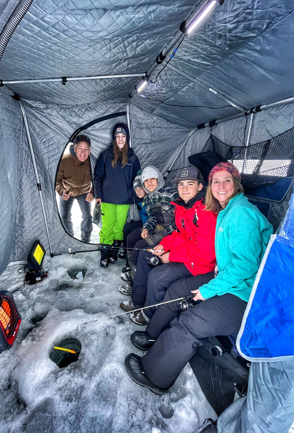 Group in Otter Outdoors fish house.jpeg