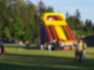 The 25ft Bouncy Slide at a bounce house party at a school in Renton WA