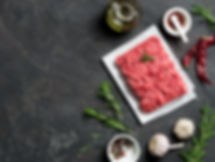 Fresh raw minced beef on backing paper a