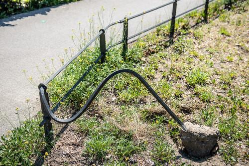 bent fence along the way