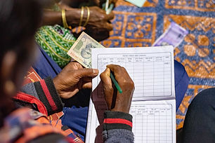 A-fieldworker-making-an-entry-in-a-finan