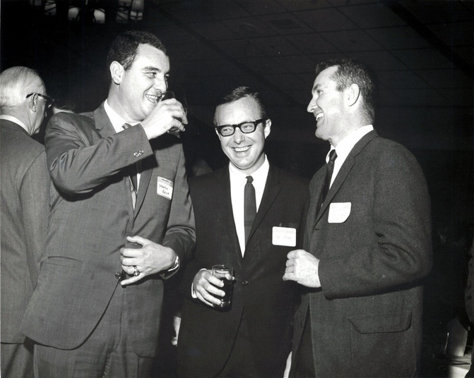 c. 1960's: Houston Alumni Chapter, Wild Game Dinner, Sagewood Country Club, Houston, late 1960s. Alpha Nu Alums (L to R): Stanley Krist, Alumni Chapter President Elect Ed Hill, Texas '55, (34th HAC President) and Patton Caldwell.
