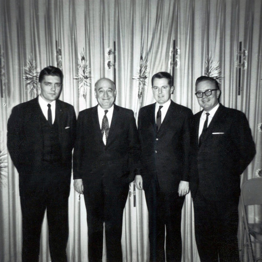 c. 1963: Houston Alumni Chapter Wild Game Dinner, Fall 1963.( L to R): Stan Henderson, Texas '59 (30th HAC President), William J. Knight, Arkansas '20 (5th HAC President), Edward O. Gaylord, Milton Jackson, Texas '49, (25th HAC President)--all members of the Houston Grand Chapter organizing committee.