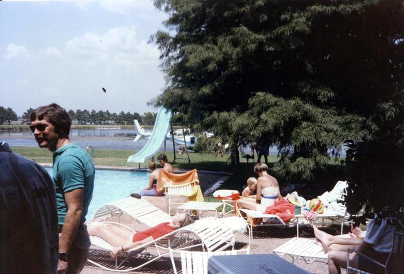 c. 1985: Houston Alumni Chapter Alumni Picnic, Bud Adams Ranch, Waller, Texas, July 27, 1985. Pool and Private Ranch Lake.