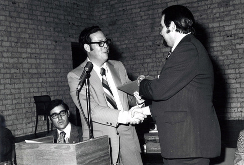 c. 1973: Houston Alumni Chapter, Wild Game Dinner, January 31, 1973. Presentation of the James E. Montgomery award by Laurie Daniels to Bill Mills, Sam Houston '60, president of the Houston Alumni Chapter, 1972-1973.