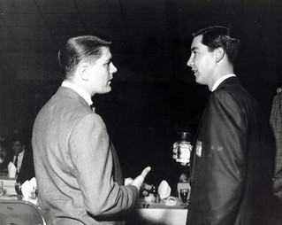 c. 1960's: Houston Alumni Chapter, Wild Game Dinner, Sagewood Country Club, Houston, late 1960s. (L to R): Stan Henderson, Texas '59, (30th HAC President) and Charlie Edminston discuss college days at Texas U.