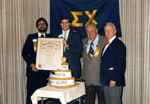 c.1982: Houston Alumni Chapter, passing of the charter from (L to R): 47th HAC past president, Pat Delmore, Houston '76, to incoming 48th HAC president, Glen Gill, LSU '74. Also shown, (L to R): 7th HAC president Pop Harkins, LSU '27, and 51st Grand Consul George Jones, LSU '42.