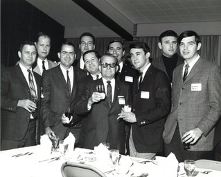 c. 1960's: Houston Alumni Chapter, Wild Game Dinner, Sagewood Country Club, Houston, late 1960s. The Beaumont Delegation surrounds Grand Trustee Don Walker (center). (L to R) are Epsilon Chi Chapter Advisors Huey Fears and Martin Edwards, Jim Crossland, Leslie Jeffers, Jim Ortiz, Walker, Don Martin, Skip Butler (Consul-Epsilon Chi),Morton Moriarity and Richard Delamoty.