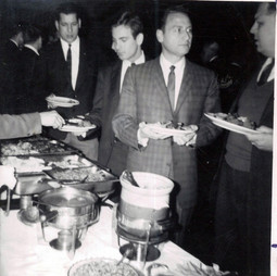 c. 1963: Houston Alumni Chapter Wild Game Dinner, Fall 1963. the buffet line, no identification.