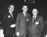 c. 1960's: Houston Alumni Chapter, Wild Game Dinner, Sagewood Country Club, Houston, late 1960's. (L to R): Tom Burke, Sam Houston '54 (32nd HAC President) and Vice President Elect Richard Gemmer (past National Jaycee outstanding Young Man of the Year) greet 44th Grand ' Consul Floyd Baker, Nebraska '37.