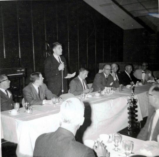 c. 1962: Houston Alumni Chapter, unidentified function, January 1962. Head Table, (L to R): Don Walker, Ted Gaylord, Stan Henderson (conducting meeting), Jim Wasserman, Jack Fore, Texas '22 (6th HAC President), W. V. Knight, Sr., Maury Bradford, Richard Sharp, Kansas '13 (19th HAC President).