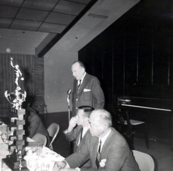 c. 1962: Houston Alumni Chapter, unidentified function, January 1962. Hurley Hust, Arkansas '22, (29th HAC Chapter President) accepting the office of president.