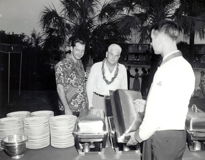 c. 1959: Houston Alumni Chapter Hawaiian Party at Shamrock Hilton, September 9, 1959. (L to R): Rod Morgan, Western Reserve '50 (resident manager of the hotel); Louis Bonner, Texas '30, 26th President of the Houston Alumni Chapter.