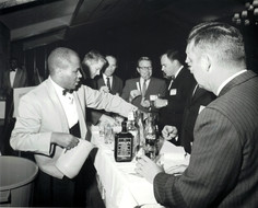 c. 1960's: Houston Alumni Chapter, Wild Game Dinner, Sagewood Country Club, Houston, late 1960s. One of the bars. (L to R): Jim Gammage, Hollis Price, Paul Pieri, Bob McNair, Huey Fears.
