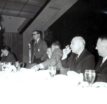 c. 1962: Houston Alumni Chapter, unidentified function, January 1962. Donald E. Walker addresses the gathering.