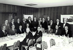 c. 1961: Houston Alumni Chapter function--no identifications, but 38th Grand Consul, J. Dwight Peterson is seated in the first chair at far left; Fraternity Executive Secretary, William Bringham is seated at 3rd from left; possibly 42nd Grand Consul, Harry V. Wade is seated at left on the inside of the table--looking backward at the camera; and 41st Grand Consul, William P. Huffman is the 4th person from right in the back row--he is taller than the others.