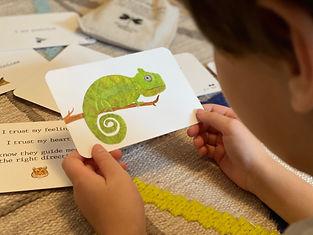 Liam reading backside of chameleon.jpg