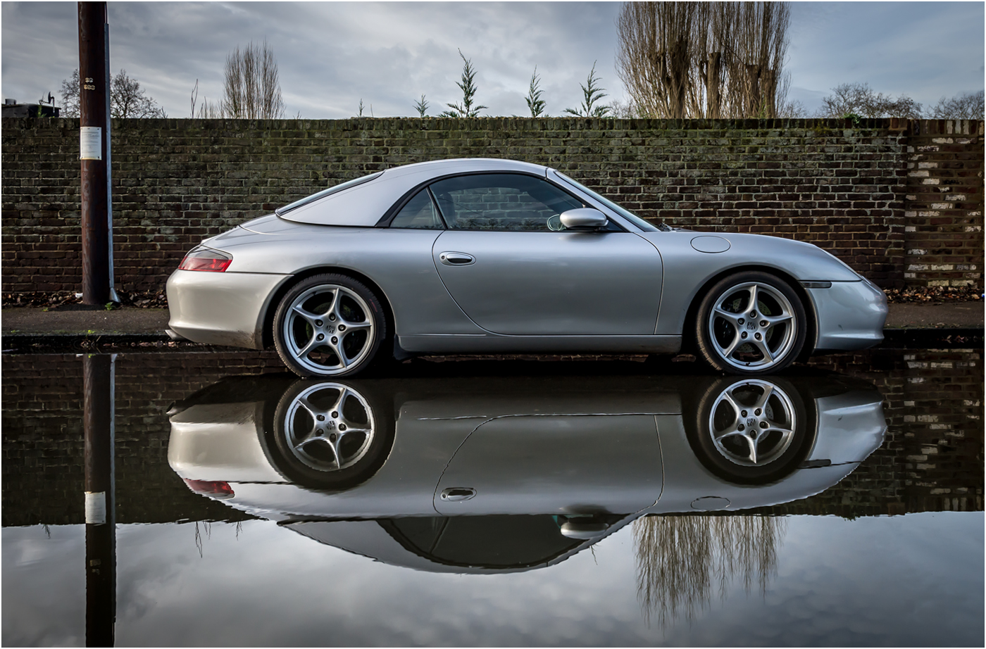 PORSCHE IN A PUDDLE by Jerry Lake.jpg