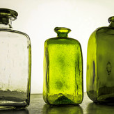 THREE GREEN BOTTLES SITTING ON A WALL by