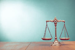 Law scales on table. Symbol of justice.j