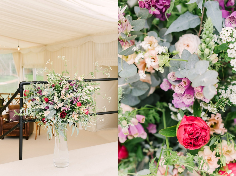 Close ups of large marquee floral installation including red roses and purple foxgloves
