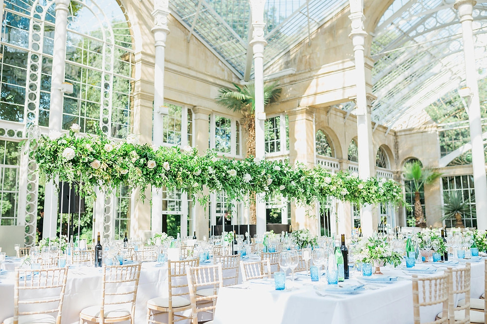 Floating installation by Emma Soulsby Flowers with jasmine and peonies in Syon Park's Great Conservatory