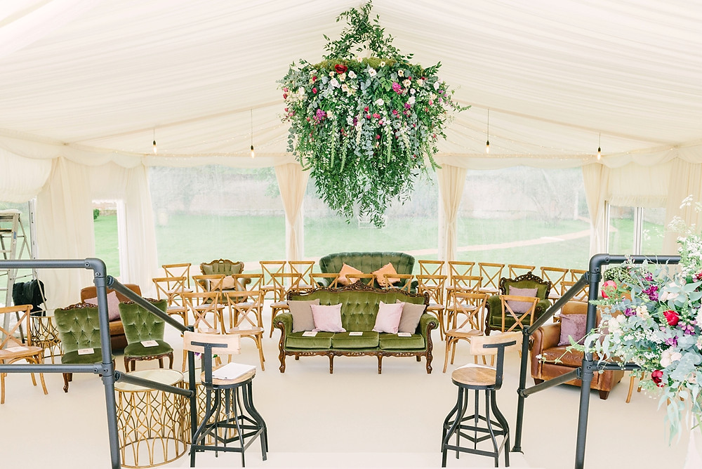 Large hanging 'flower ball' installation in a luxury marquee by Emma Soulsby Flowers.