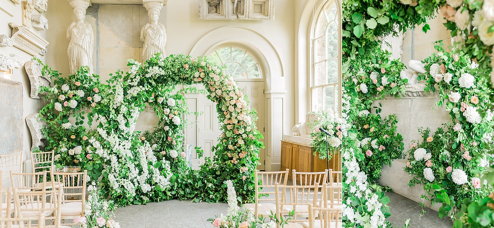 Lush dramatic floral arch with roses and delphiniums at Aynhoe Park