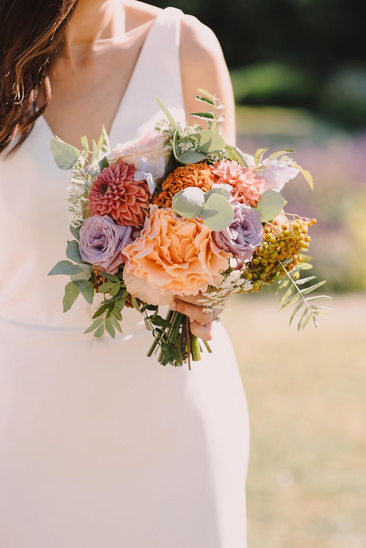 Close up of bridal bouquet including celosia and dahlias
