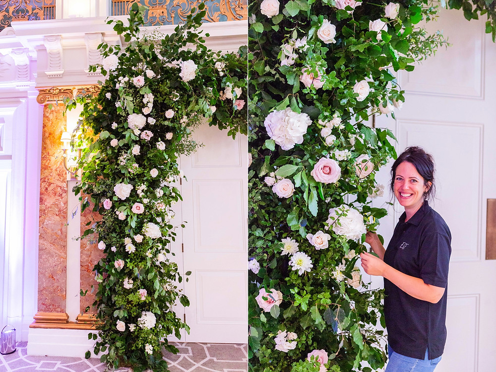 Close up details of large floral arch at the Kimpton Fitzroy. Luxury florist Emma Soulsby putting finishing touches to it with roses and hydrangeas