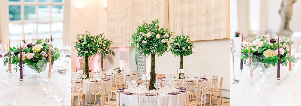 Tall tablescape trees and low glass vase arrangements with taper candles at Kew Gardens wedding