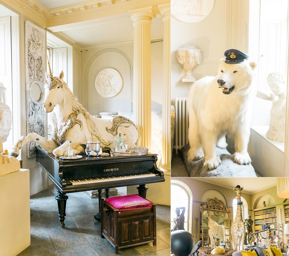 Collection of taxidermy at Aynhoe park. Unicorn, polar bear and giraffes.