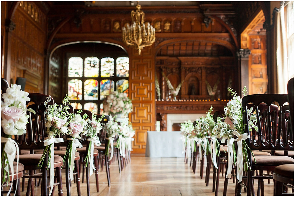Ceremony room at Two Temple Place. Chairs set up with posies on each one.
