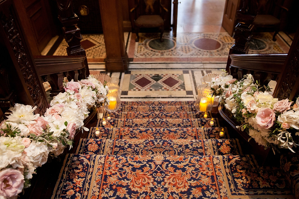 Staircase floral arrangement at Two Temple Place by Emma Soulsby Flowers