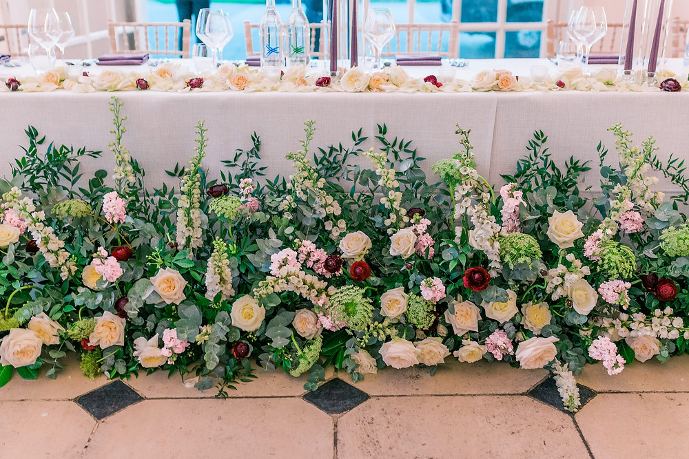 Close up of top table meadowscape at Kew Gardens Orangery in shades of white, cream and burgundy