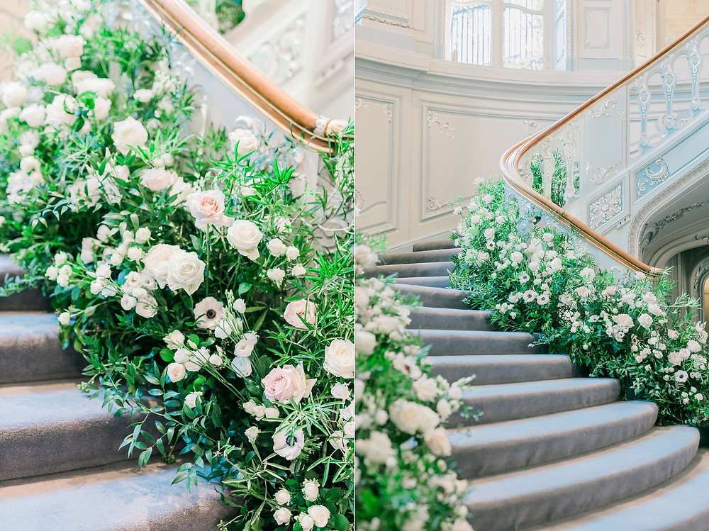 Luxury white staircase floral installation at The Savile Club featuring anemones orchids and roses