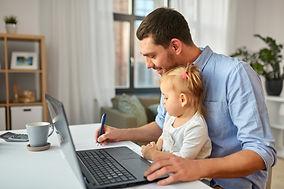 Dad & child home working AdobeStock_3099
