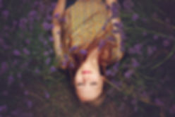 Canva - Woman Lying on a Lavender Field.