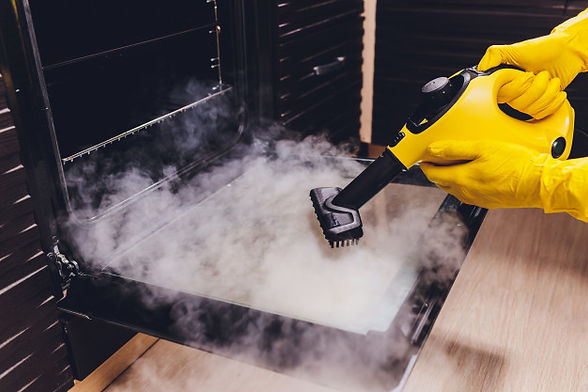 steam-cleaning-oven-house-cleaning-hand-