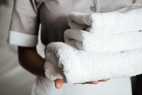 close-up-young-maid-holding-folded-towel