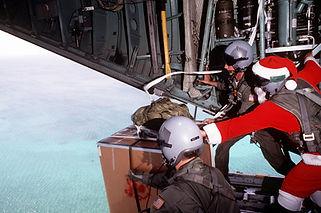 three-crewmen-one-dresses-as-santa-push-