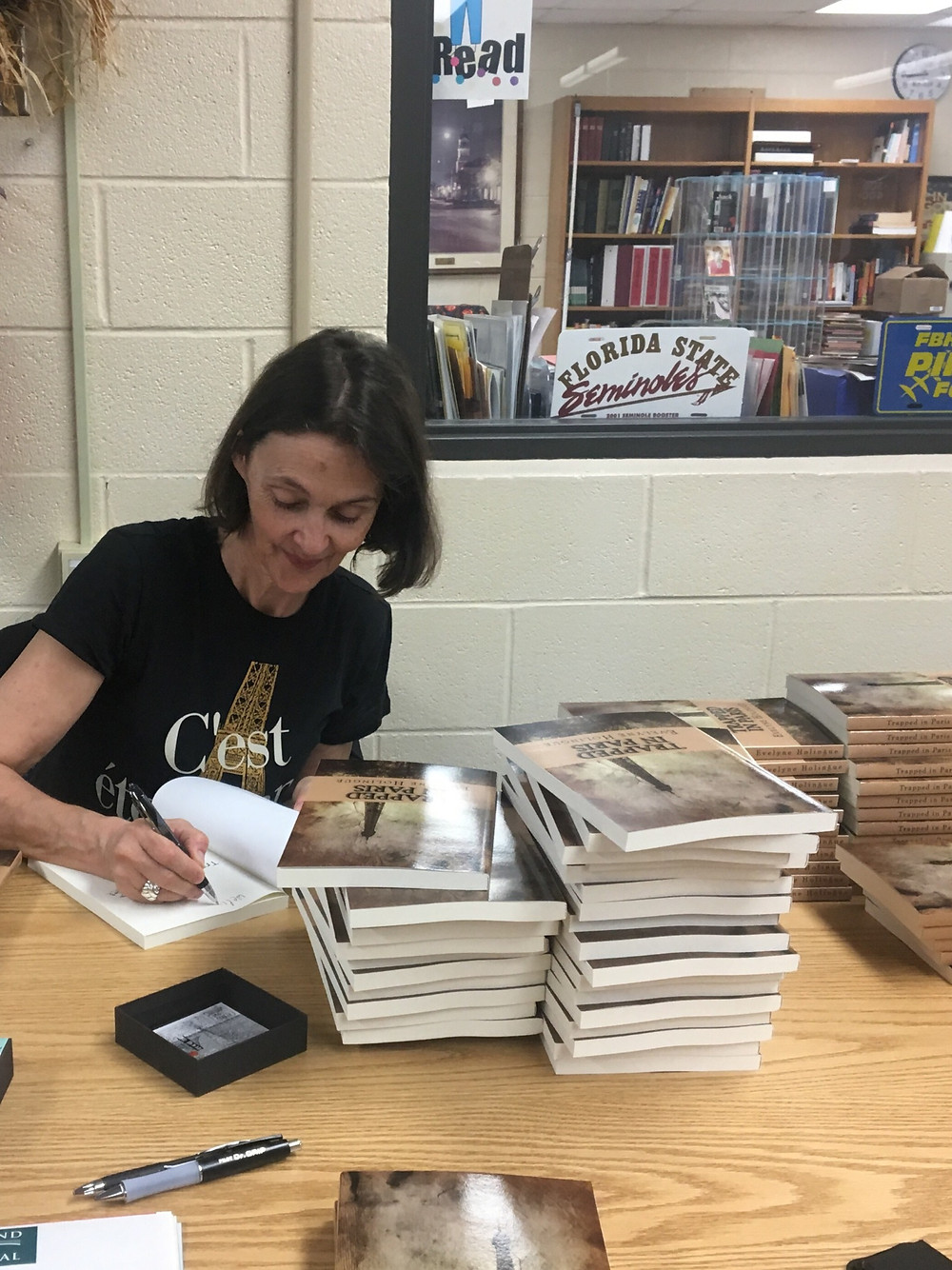 Evelyne signing books for students at FBHS in  2020