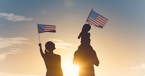 Patriotic silhouette of family waving USA Flag