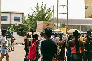 storyblocks-ghanaian-people-walking-in-neighborhood_B2eI9TjhKP.jpg