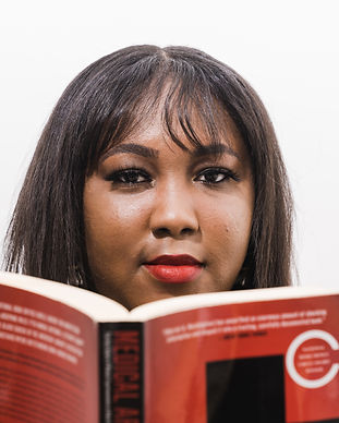 storyblocks-black-woman-therapist-reading-a-book-in-therapy-session_2.jpg