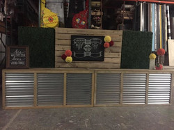 Hedge walls, slat wall, custom bars, chalk art